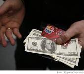 Что ждет в 2015 году владельцев банковских карт